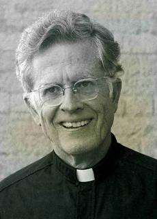 portrait shot of Fr Richard M Thomas S.J.