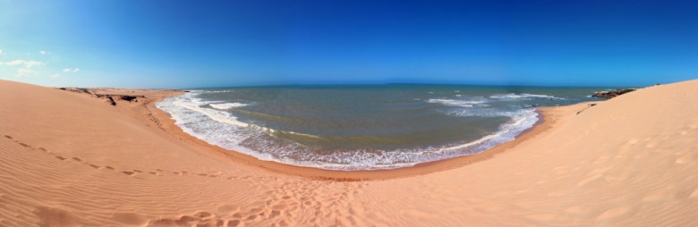 The view from the top of the 60m tall sand dunes down to the beautiful ocean.