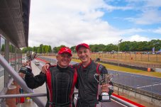 Philippe Loup and son Jean-Baptiste celebrate on their race two podium