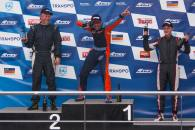georges-williams-and-j-b-loup-celebrate-on-the-race-one-podium