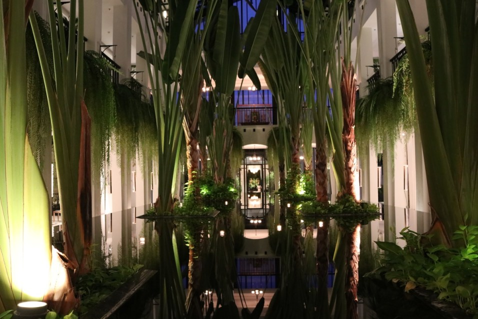 Indoor garden at night - The Siam Hotel