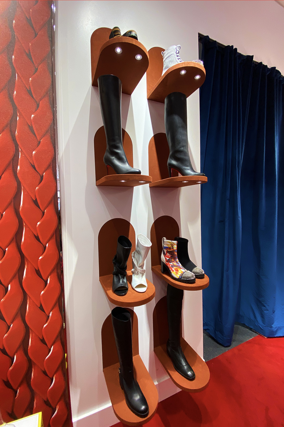 Christian Louboutin Outlet Boot Wall (The Luxury Lowdown Blog)