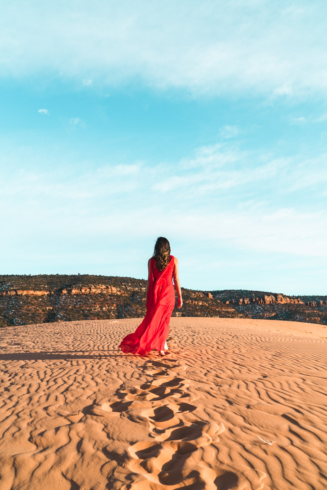 Back picture in red dress at Coral Pink Sand Dunes