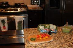 tomatoes, spinach, basil, and hummus