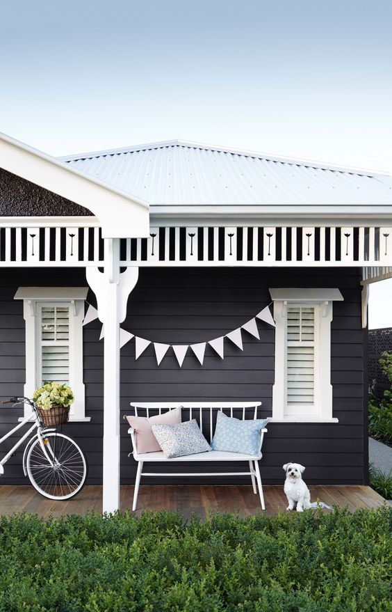Charcoal home with bench