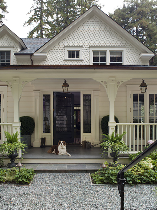An Old White Folk Victorian Farmhouse Exterior with Front Porch
