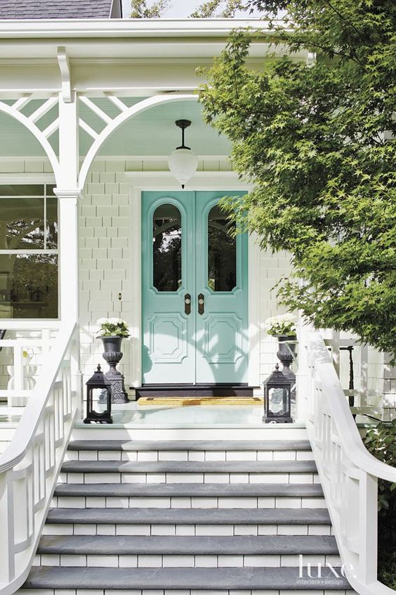 White Folk Victorian house with Mint Front Doors