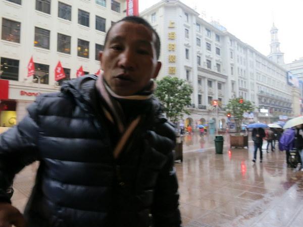 An irritating sex hawker in Shanghai's Nanjing Road.