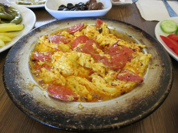 Not true menemen: this version adds some slices of sucuk (sausage). Nice, but not the same.