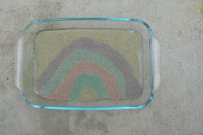 Painting a rainbow with colored sand