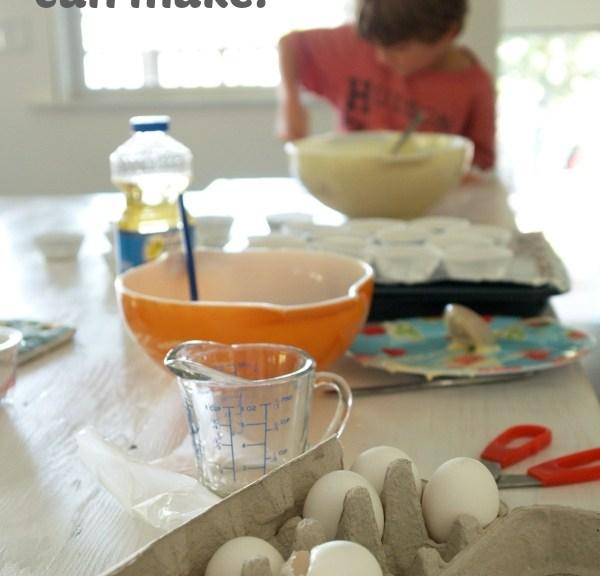 photo of a kid making a cupcake