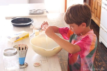 photo of a kid baking a cake