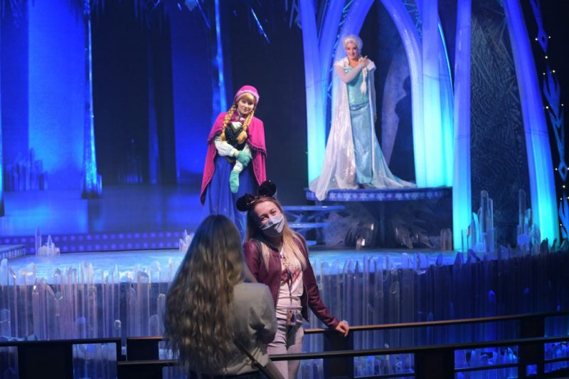 Guests taking a photo with Anna and Elsa at Disneyland Paris
