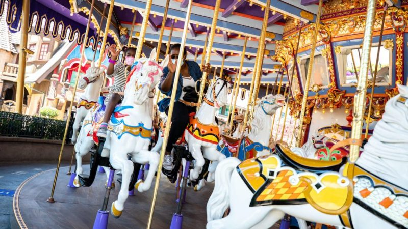 Guests on King Arthur Carrousel as Disneyland Park