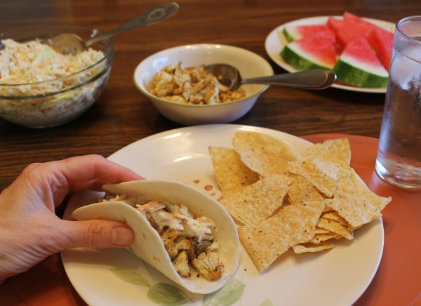 Making tacos from seasoned cauliflower and coleslaw