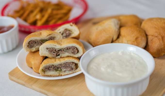 philly steak and cheese bombs biscuits serving board philly cheese sauce french friends ketchup