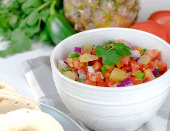 This Pineapple Pico de Gallo is incredibly easy to make, is made with fresh ingredients, and is ready in less than 10 minutes. #picodegallo #salsa #fresh