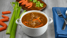 Instant Pot Beef Stew with celery stalks and baby carrots