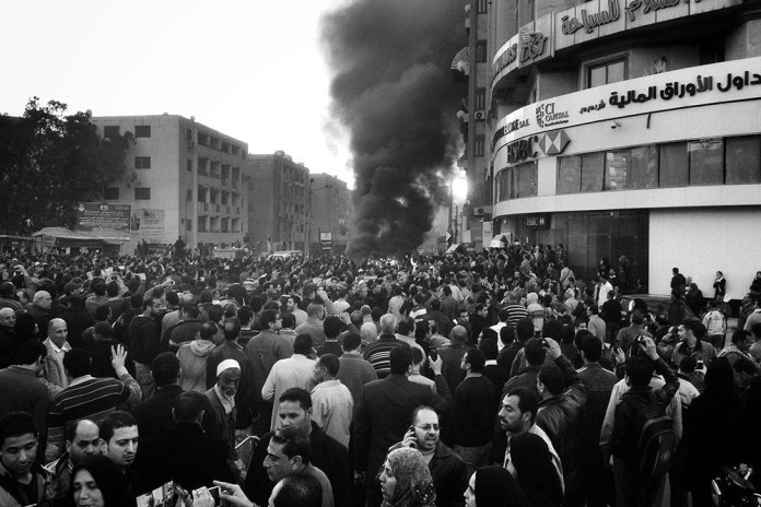 PHOTO JOURNALISM 1ST PLACE, A CAR IS ON FIRE - TALKHA CITY, EGYPT by Chaoyue Pan