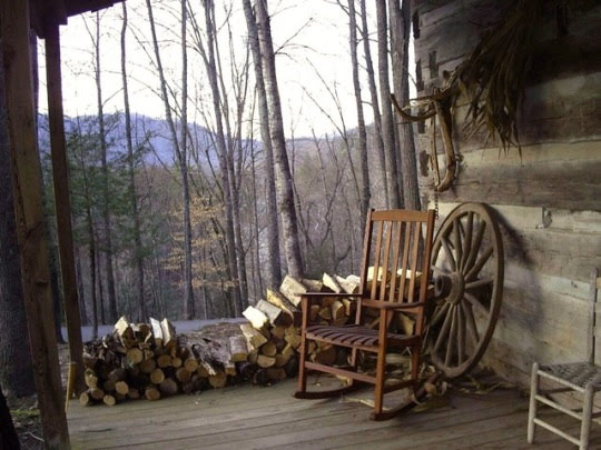 old porch with rocking chair and firewood