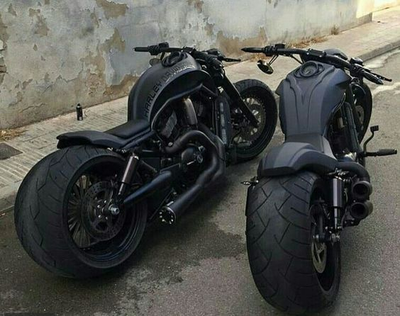 two fat blacked out motorcycles