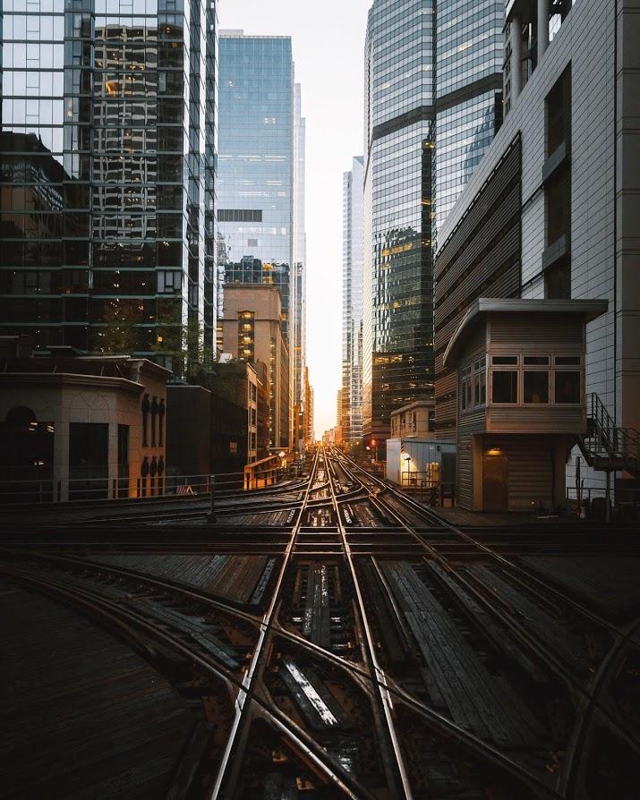 city train tracks at sunrise