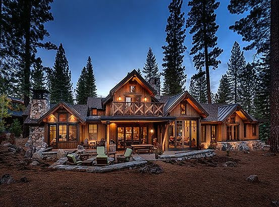 large rustic home in the woods
