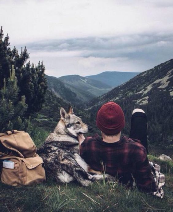 man relaxing with dog