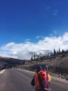 man on road to mountain