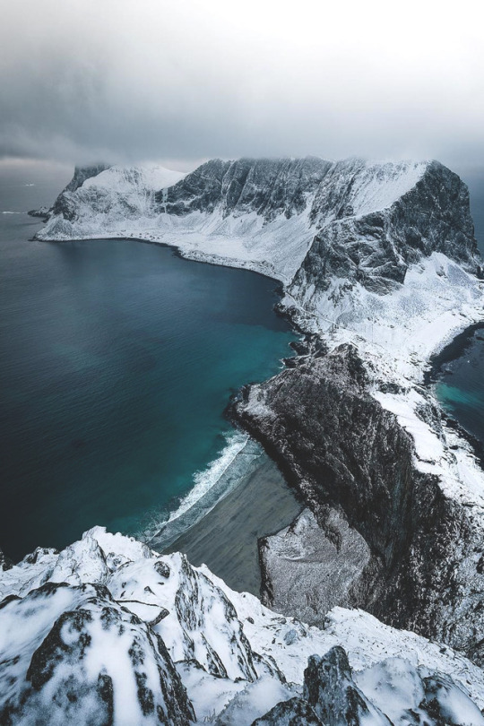 cold snowy mountains by the shore