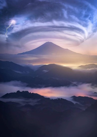 colorful clouds and lightning over mountain