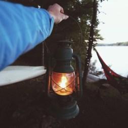 lantern at campsite by lake