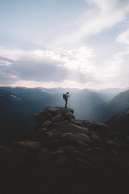 man standing on rocky ledge