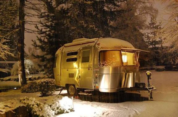 old school camper in the snow