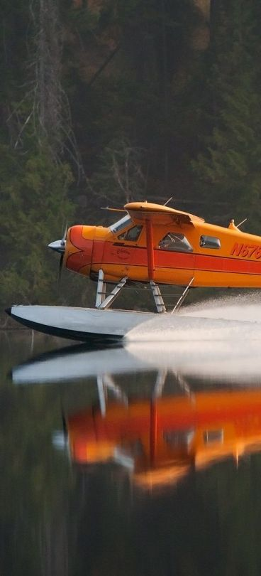 plane landing on lake