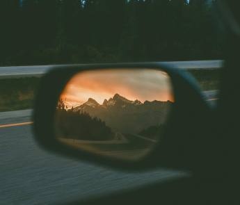 rearview mirror view of mountains