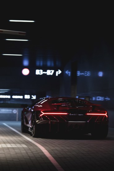 red supercar at night
