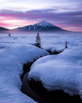 snow mountain and creek