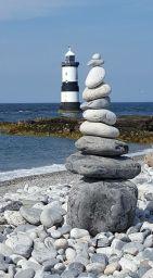 zen rocks in front of lighthouse