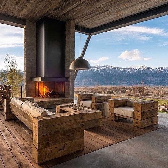 outdoor seating with fireplace and mountain view
