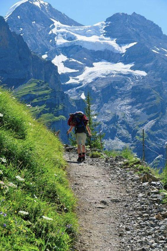 man hiking on mountain trail