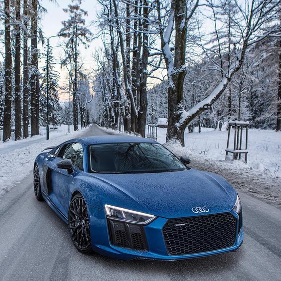 blue audi in the snow