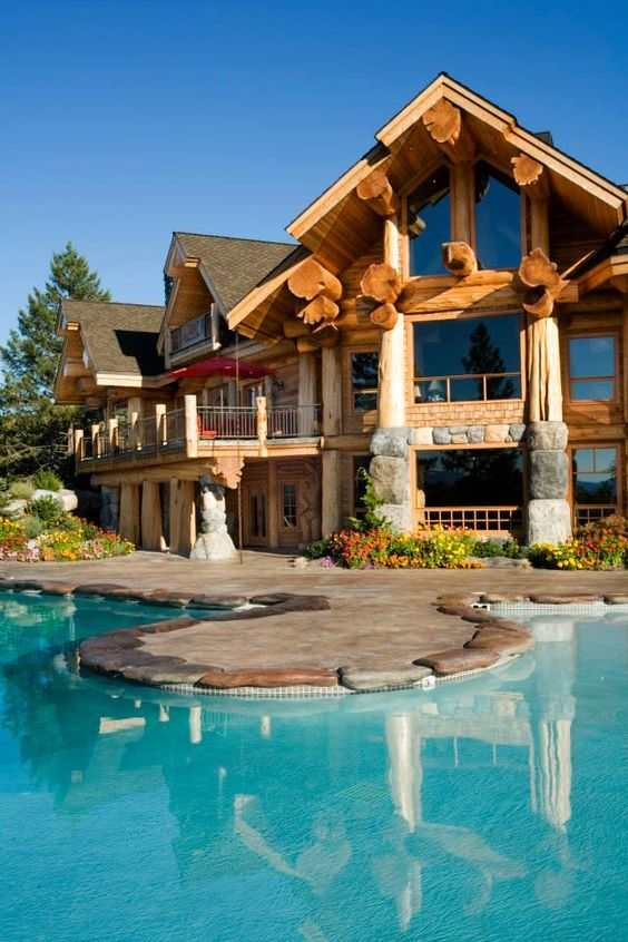 large rustic home with pool