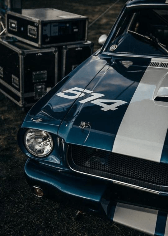 blue mustang with white racing stripe
