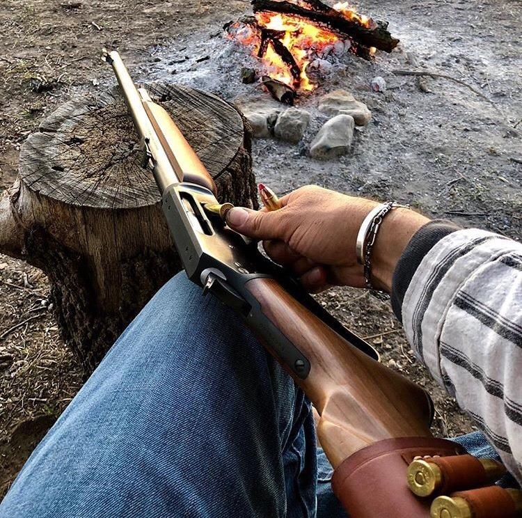 man loading shotgun