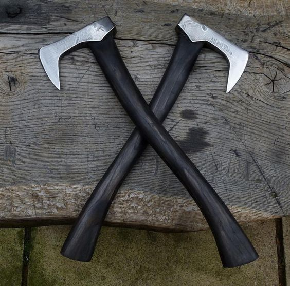 two black handled axes