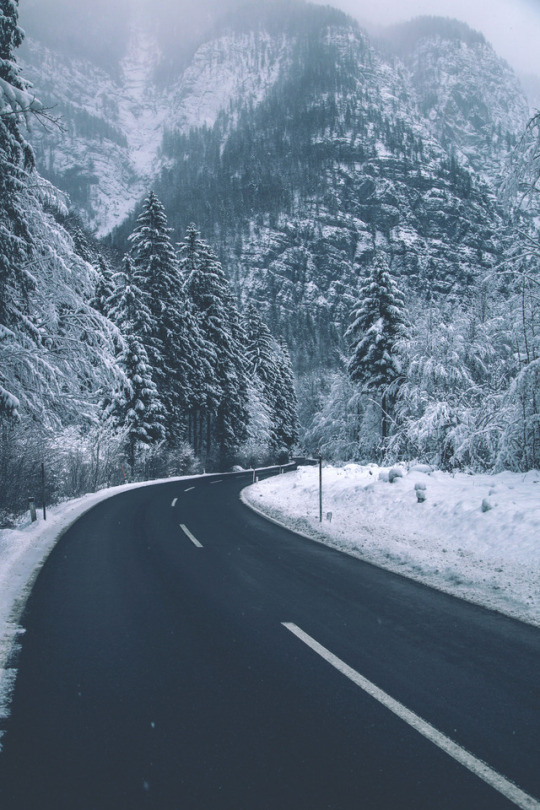 snowy road through mountains