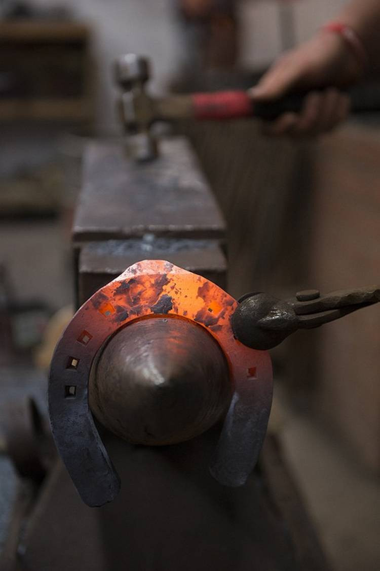 blacksmith forging horseshoe