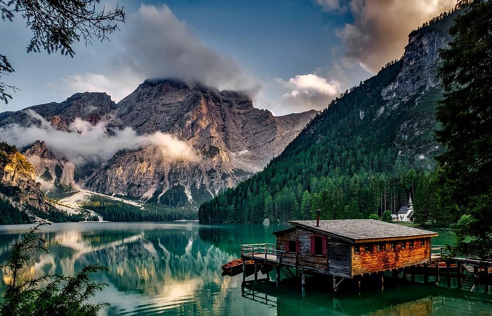 calm mountain lake and cabin