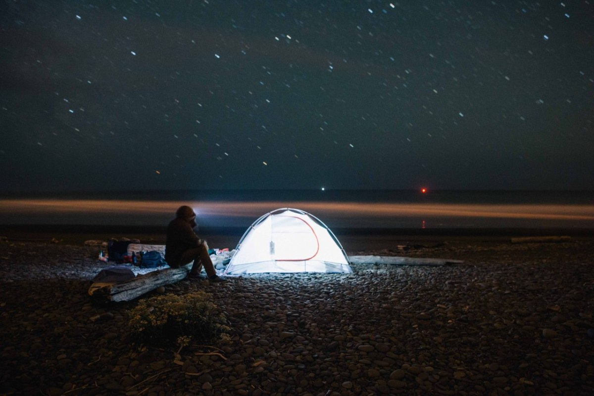 glowing tent on beach at night